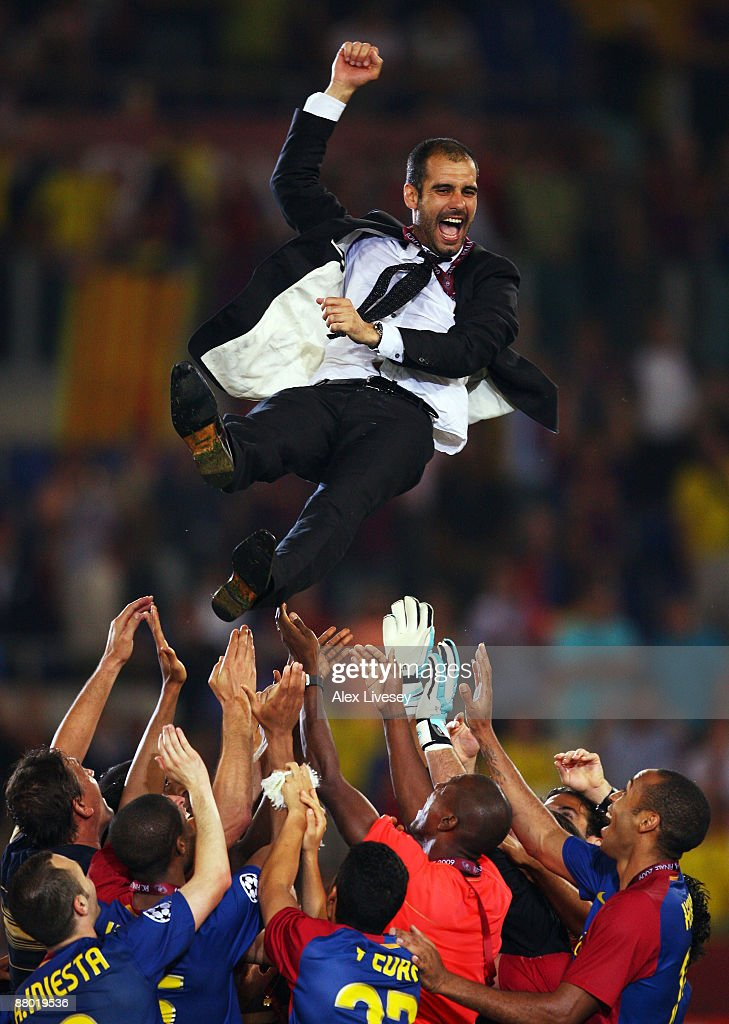 Josep Guardiola coach of Barcelona is thrown into the air by his players as they celebrate winning the UEFA Champions League Final match between Manchester United and Barcelona at the Stadio Olimpico on May 27, 2009 in Rome, Italy.