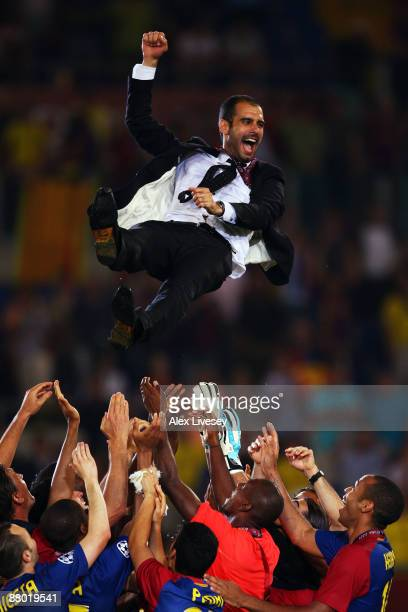 Josep Guardiola coach of Barcelona is thrown into the air by his players as they celebrate winning the UEFA Champions League Final match between...