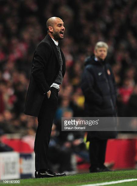 Josep Guardiola Coach of Barcelona watches with Arsene Wenger Manager of Arsenal during the UEFA Champions League round of 16 first leg match between...