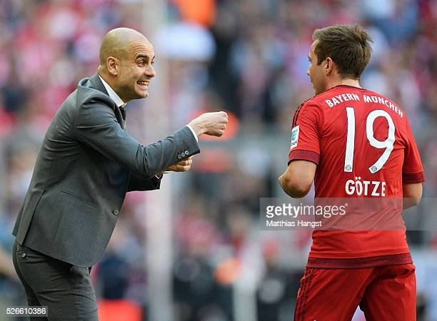 Josep Guardiola coach of Bayern Muenchen instructs to his player Mario Goetze during the Bundesliga match between FC Bayern Muenchen and Borussia...