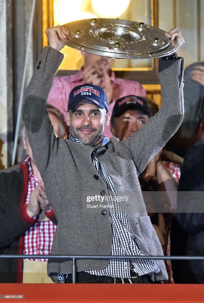 Josep Guardiola, head coach of Bayern celebrates with the players of FC Bayern Muenchen celebrate at the Rathaus on May 10, 2014 in Munich, Germany.