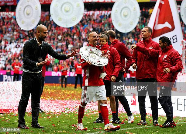 Josep Guardiola head coach of Bayern Muenchen and Franck Rebery of Bayern Muenchen hold the Meisterschale as they celebrate the Bundesliga champions...