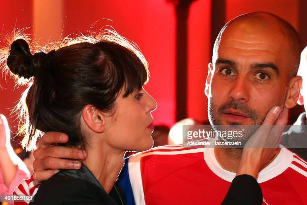 Josep Guardiola head coach of Bayern Muenchen and his wife Cristina Serra during the FC Bayern Muenchen Champions party after winning the German DFB...