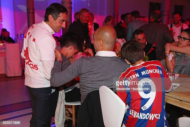 Josep Guardiola head coach of Bayern Muenchen attends with his son the FC Bayern Muenchen champions party at Deutsche Telekom's representative office...