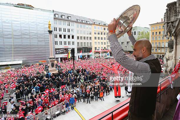 Josep Guardiola head coach of Bayern Muenchen celebrates winning the German Championship title on the town hall balcony at Marienplatz on May 15 2016...