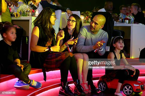 Josep Guardiola head coach of Bayern Muenchen celebrates with his family whilst singer Omi performes on stage during the FC Bayern Muenchen...