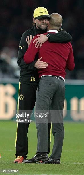 Josep Guardiola head coach of Bayern Muenchen hugs Juergen Klopp head coach of Borussia Dortmund after winning the DFB Cup Final match between...