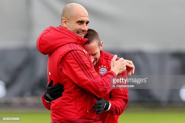 Josep Guardiola head coach of Bayern Muenchen jokes with his player Franck Ribery during his first training session with the team at Bayern...