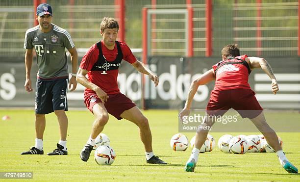 Josep Guardiola Head Coach of Bayern Muenchen keeps a close eye on Thomas Mueller of Bayern Muenchen during the FC Bayern Muenchen Training Session...