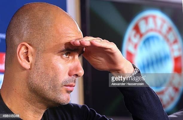 Josep Guardiola head coach of Bayern Muenchen looks on during a FC Bayern Muenchen press conference on the eve of their UEFA Champions League match...