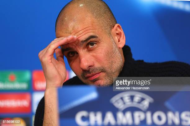 Josep Guardiola head coach of Bayern Muenchen looks on during a Bayern Muenchen press conference ahead of the UEFA Champions League match against...
