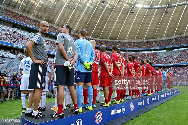 Josep Guardiola head coach of Bayern Muenchen looks on during the FC Bayern Muenchen season opening and team presentation at Allianz Arena on July 11...