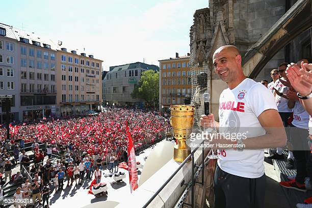 Josep Guardiola, head coach of Bayern Muenchen speaks to the crowd as the team celebrates winning the DFB German Cup title on the town hall balcony...