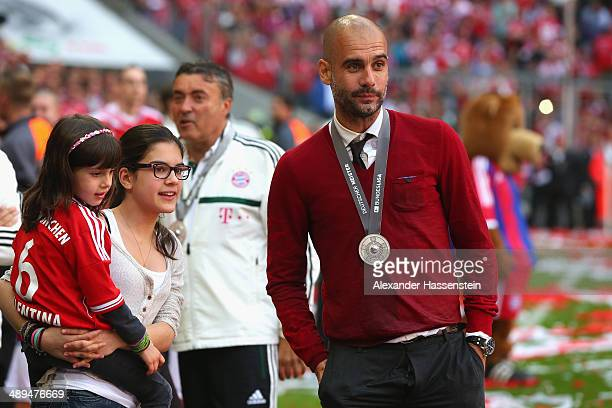 Josep Guardiola head coach of Bayern Muenchen talks to his daughters Maria Guardiola and Valentina Guardiola after the Bundesliga match between...
