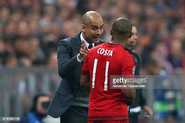 Josep Guardiola head coach of Bayern Muenchen talks to his player Douglas Costa during the UEFA Champions League quarter final first leg match...