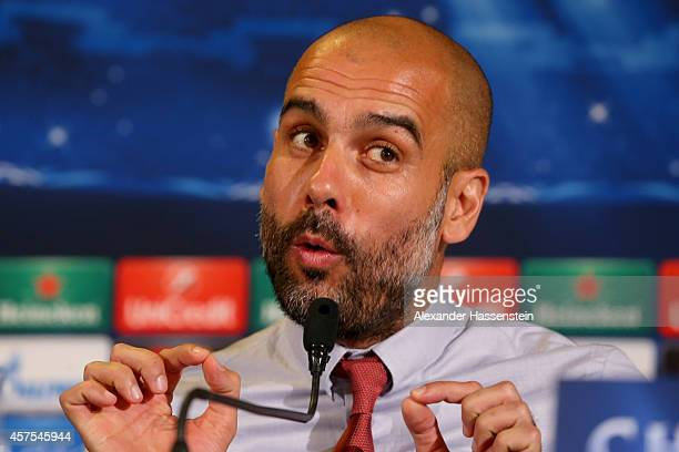 Josep Guardiola head coach of Bayern Muenchen talks to the media during a press conference prior to their UEFA Champions League match against AS Roma...