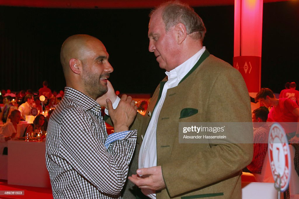 Josep Guardiola, head coach of Bayern Muenchen talks to Uli Hoeness (R), during the official Champions party at Postpalast on May 10, 2014 in Munich, Germany.