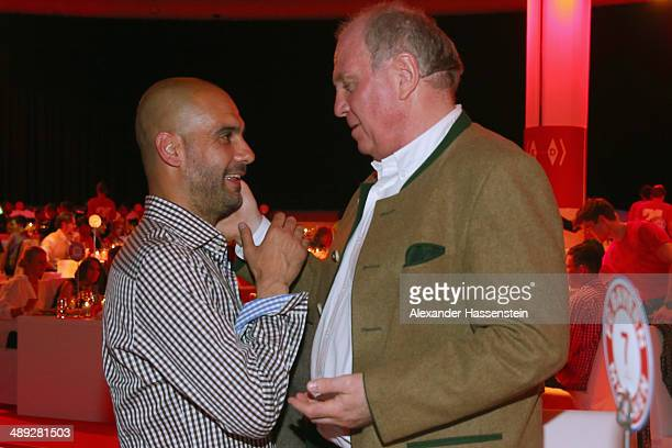Josep Guardiola head coach of Bayern Muenchen talks to Uli Hoeness during the official Champions party at Postpalast on May 10 2014 in Munich Germany
