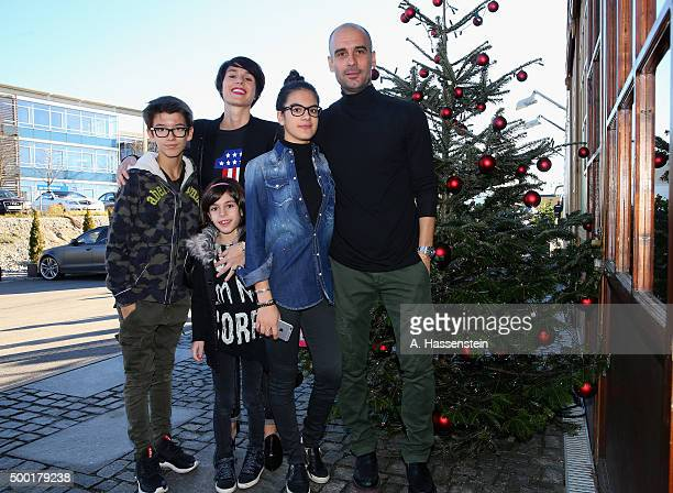 Josep Guardiola head coach of FC Bayern Muenchen arrives with his wife Cristina and his children for the FC Bayern Muenchen Christmas Party at Alfons...