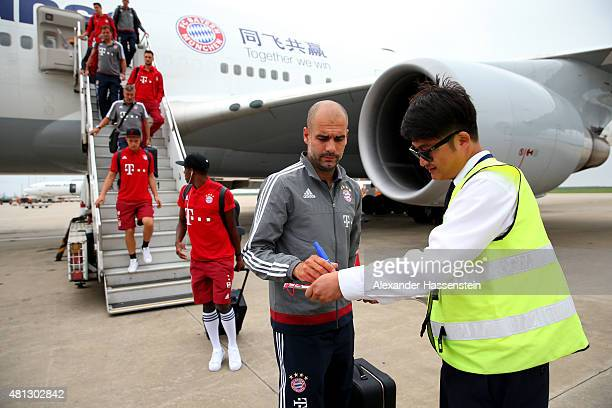 Josep Guardiola head coach of FC Bayern Muenchen arrives with the team at Shanghai Pudong International Airport during day 3 of the on July 19 2015...
