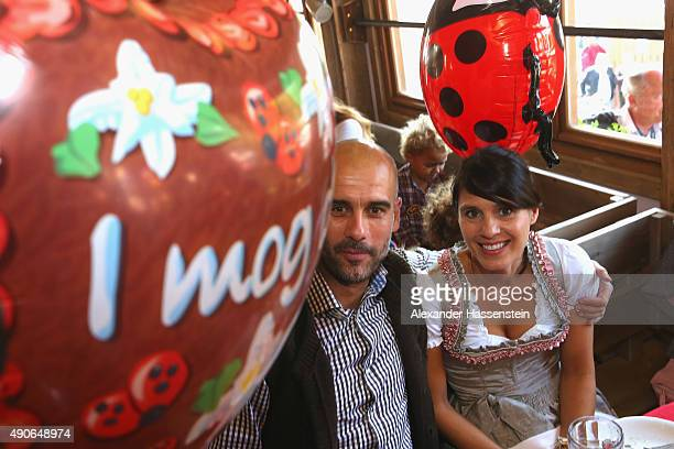 Josep Guardiola head coach of FC Bayern Muenchen attends with his wife Cristina Guardiola the Oktoberfest 2015 Beerfestival at Kaefer Wiesenschaenke...