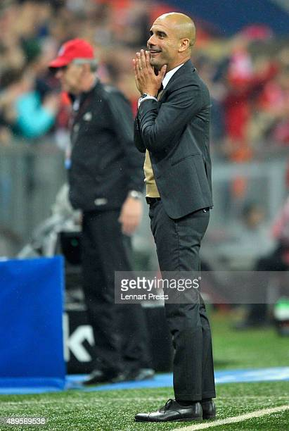Josep Guardiola, head coach of FC Bayern Muenchen celebrates his team's fifth goal duirng the Bundesliga match between FC Bayern Muenchen and VfL...