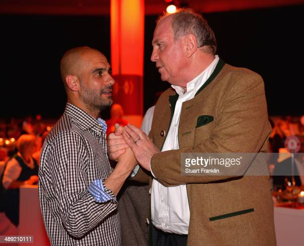 Josep Guardiola head coach of FC Bayern Muenchen greets Uli Hoeness former presdident of FC Bayern Muenchen at the official Champions party...