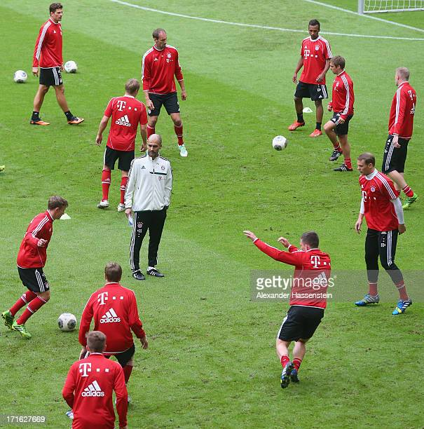 Josep Guardiola head coach of FC Bayern Muenchen looks on during a FC Bayern Muenchen training session at Allianz Arena on June 27 2013 in Munich...