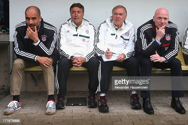Josep Guardiola head coach of FC Bayern Muenchen looks on with his assistent coaches Domenec Torrent and Hermann Gerland and Matthias Sammer Sporting...