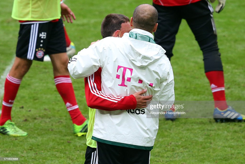 Josep Guardiola head coach of FC Bayern Muenchen reacts to Franck Ribery during a FC Bayern Muenchen training session at Allianz Arena on June 27, 2013 in Munich, Germany.