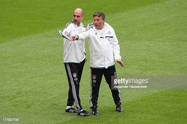 Josep Guardiola head coach of FC Bayern Muenchen talks to his assistent coach Domenec Torrent during a FC Bayern Muenchen training session at Allianz...