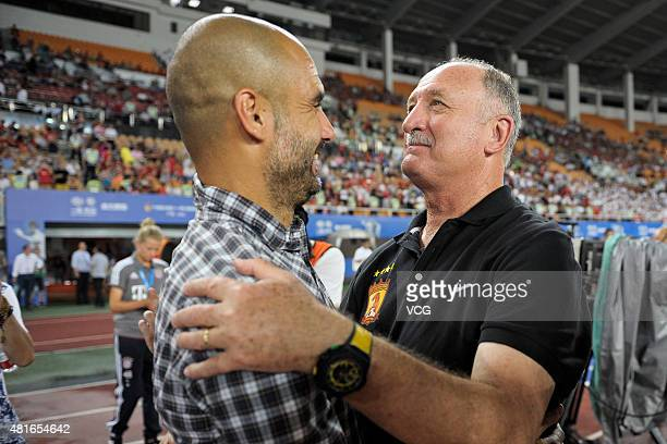 Josep Guardiola head coach of FC Bayern Muenchen talks to Luiz Felipe Scolari head coach of Guangzhou Evergrande prior to the international friendly...