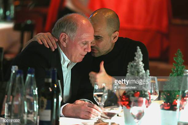Josep Guardiola head coach of FC Bayern Muenchen talks to Uli Hoeness during the FC Bayern Muenchen Christmas Party at Alfons Schuhbeck`s...