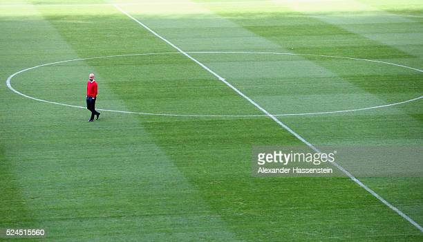 Josep Guardiola head coach of FC Bayern Muenchen visits the field of play prior to a press conference on the eve of the UEFA Champions League Semi...