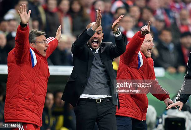 Josep Guardiola, head coach of Muenchen and Mathias Sammer, sports director of Muenchen react at an appeal for handball during the DFB Cup Semi Final...