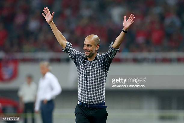 Josep Guardiola head coach of Muenchen celebrates the first team goal during the international friendly match between FC Bayern Muenchen and Inter...
