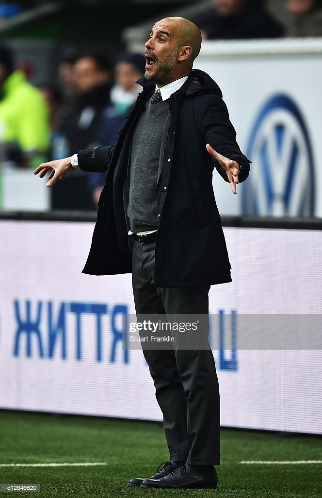 Josep Guardiola, head coach of Muenchen gestures during the Bundesliga match between VfL Wolfsburg and FC Bayern Muenchen at Volkswagen Arena on February 27, 2016 in Wolfsburg, Germany.