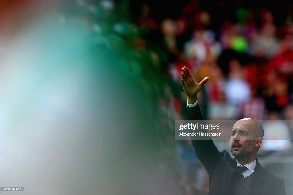 Josep Guardiola, head coach of Muenchen reacts during the Bundesliga match between Sport Club Freiburg and FC Bayern Muenchen at Schwarzwald-Stadion on May 16, 2015 in Freiburg im Breisgau, Germany.
