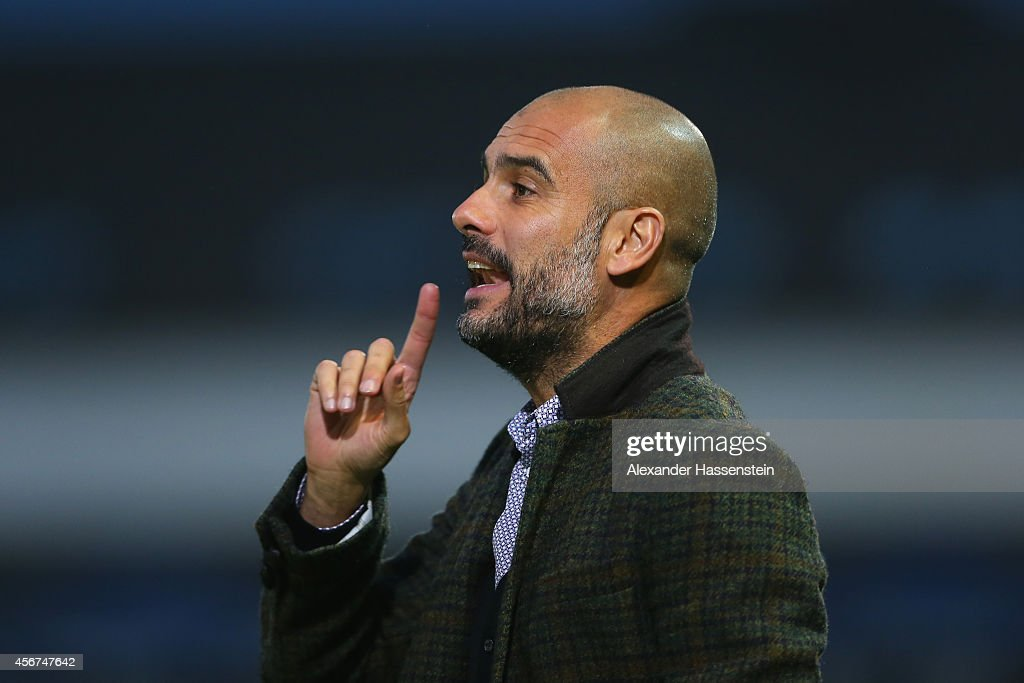 Josep Guardiola, head coach of Muenchen reacts during the Finale of the Paulaner Cup 2014 between FC Bayern Muenchen and Paulaner Traumelf at Alpenbauer Sportpark on October 6, 2014 in Unterhaching, Germany.