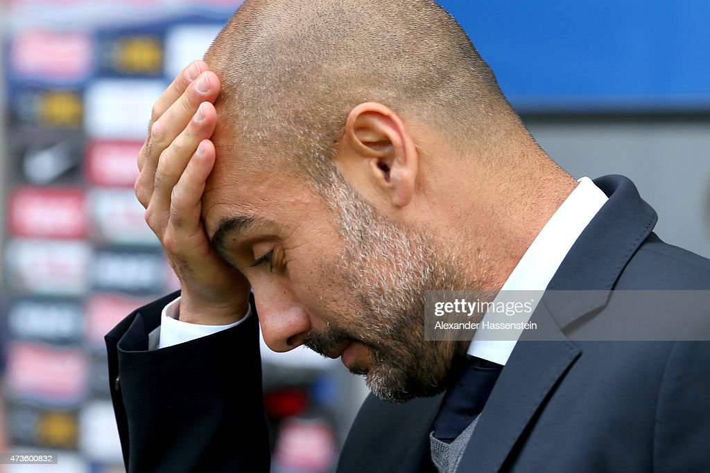 Josep Guardiola, head coach of Muenchen reacts prior to the Bundesliga match between Sport Club Freiburg and FC Bayern Muenchen at Schwarzwald-Stadion on May 16, 2015 in Freiburg im Breisgau, Germany.