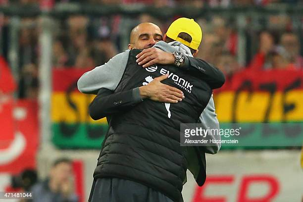 Josep Guardiola head coach of Muenchen reacts with Juergen Klopp head coach of Dortmund prior to the penalty shot out of the DFB Cup Semi Final match...