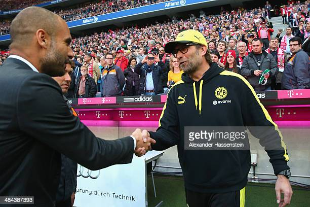 Josep Guardiola head coach of Muenchen shake hands with Juergen Klopp head coachof Dortmund prior to the Bundesliga match between FC Bayern Muenchen...