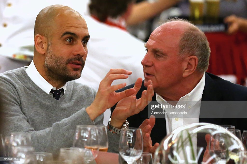 Josep Guardiola (L), head coach of Muenchen talks to Uli Hoeness during the Champions Banquette at EPIC SANA Lisboa Hotel after winning the UEFA Champions League quarter final second leg match between SL Benfica and FC Bayern Muenchen at Estadio da Luz on April 13, 2016 in Lisbon, Portugal.