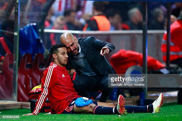 Josep Guardiola manager of Bayern Munich in discussion with an injured Thiago Alcantara of Bayern Munich during the UEFA Champions League semi final...