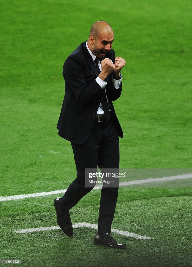 Josep Guardiola manager of FC Barcelona celebrates as his team score a third goal during the UEFA Champions League final between FC Barcelona and Manchester United FC at Wembley Stadium on May 28, 2011 in London, England.
