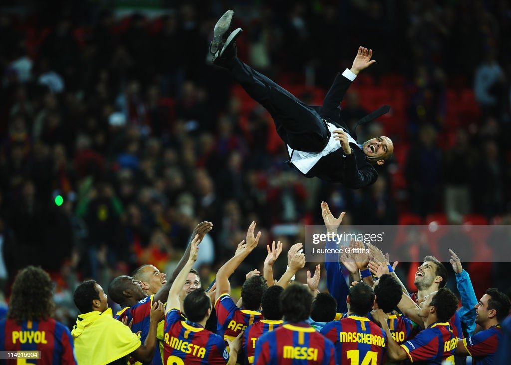 Josep Guardiola manager of FC Barcelona is thrown in the air as Barcelona celebrate victory in UEFA Champions League final between FC Barcelona and Manchester United FC at Wembley Stadium on May 28, 2011 in London, England.
