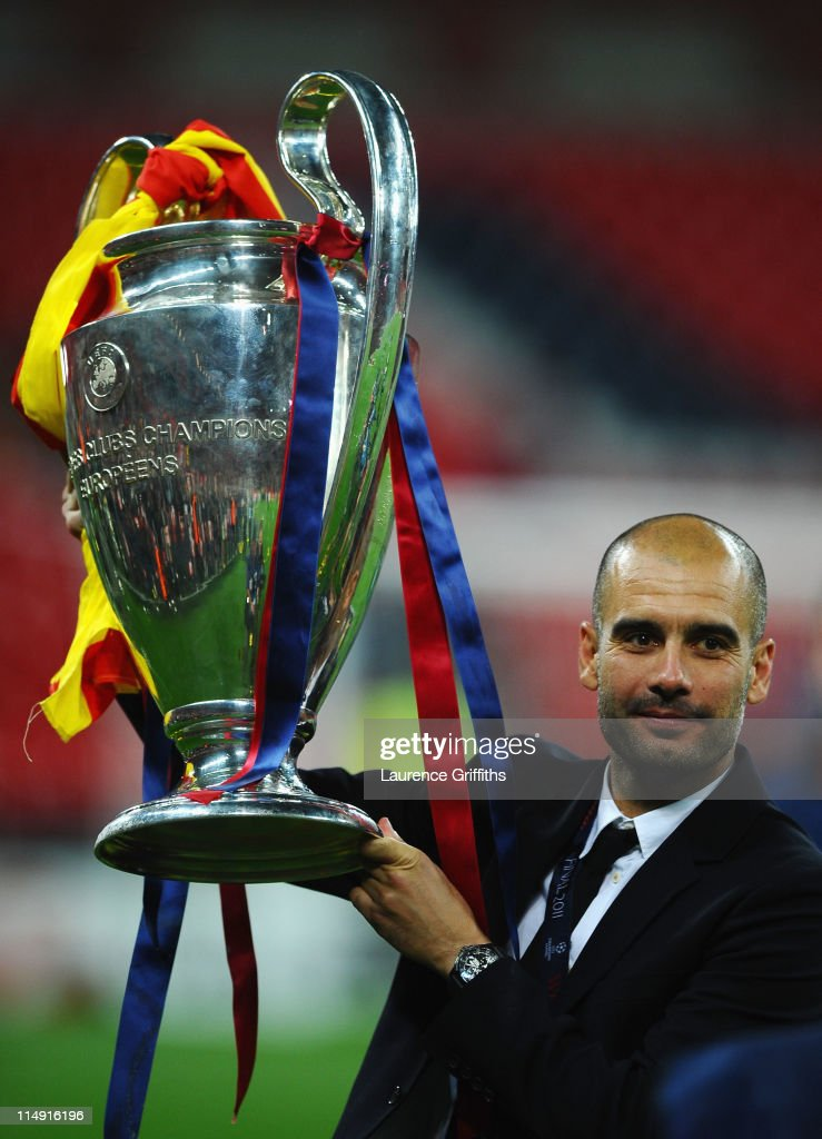 Josep Guardiola manager of FC Barcelona lifts the trophy after victory in the UEFA Champions League final between FC Barcelona and Manchester United FC at Wembley Stadium on May 28, 2011 in London, England.
