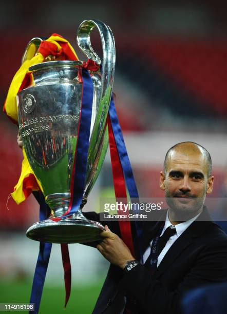 Josep Guardiola manager of FC Barcelona lifts the trophy after victory in the UEFA Champions League final between FC Barcelona and Manchester United...