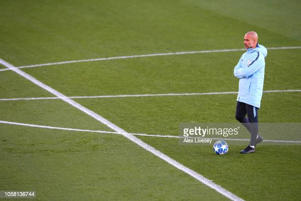 Josep Guardiola Manager of Malnchester City looks on during a Manchester City training session at Manchester City Football Academy on November 6 2018...