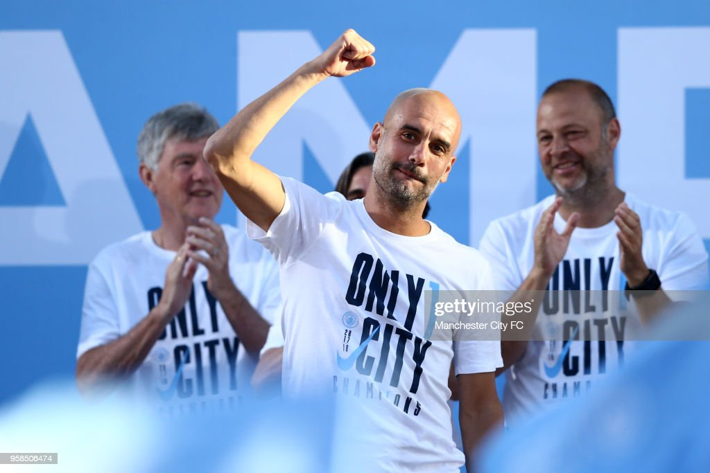 Josep Guardiola, Manager of Manchester City acknowledge the fans from the stage during the Manchester City Trophy Parade on May 14, 2018 in Manchester, England.
